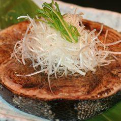 料理メニュー写真まぐろ尾肉のガーリックステーキ