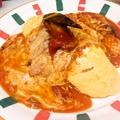 料理メニュー写真魚介類とトマトクリームのオムライス
