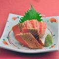 料理メニュー写真サーモンのお造り/つぶ貝のお造り