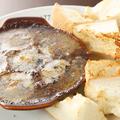 料理メニュー写真たこのエスカルゴ風バター焼き(パン付)