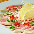 料理メニュー写真炙りサーモンのカルパッチョ