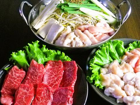 上質な但馬牛を七輪の炭火で焼いていただく。肉、ホルモン、かに、美味の饗宴。