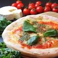料理メニュー写真純国産モッツァレラと自家製トマトソースのマルゲリータ