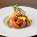 料理メニュー写真魚介の前菜(時期により異なります)写真は「タコとグレープフルーツのマリネ」