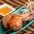 料理メニュー写真鶏肉の手羽先餃子(4個)
