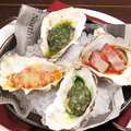 料理メニュー写真焼き牡蠣4種盛り合わせ
