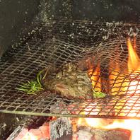 暖炉で焼き上げるメイン料理