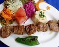 料理メニュー写真クズシシ Lamb grilled on a skewer