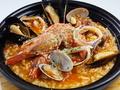 料理メニュー写真魚介たっぷりブイヤベース雑炊