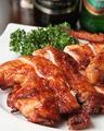 料理メニュー写真<鶏肉類>若鶏の特製唐揚げ/雛鳥のパリパリ丸揚げ(半羽)