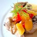 料理メニュー写真地鶏の紙包み焼きトリュフとエキストラバージンオリーブオイルの香り