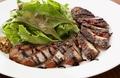 料理メニュー写真自家製・半熟ベーコンの厚切りステーキ