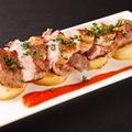 料理メニュー写真スペイン産イベリコ豚の鉄板焼き