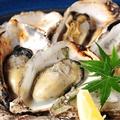 料理メニュー写真殻つき焼き牡蠣(1個)