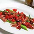 料理メニュー写真グリーンアスパラガスとハモンセラーノのコシドオエルビド