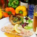 料理メニュー写真オーガニック豚のロースソテー白ワインレモンソース 玉葱のロースト付