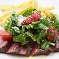 料理メニュー写真ルッコラとトマトのサラダ仕立て