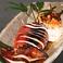 料理メニュー写真イカの一本丸焼き/海老焼売(4個)/さざえ壷焼き