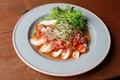 料理メニュー写真スパイシートマトのヨダレチキン