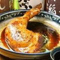 料理メニュー写真鳥取産!大山鶏の骨付きもも肉じっくりオーブン焼き