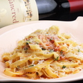 料理メニュー写真自家製トマトソースとペコリーノチーズのパスタ