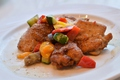 料理メニュー写真若鶏のグリル ケイジャンスパイスにパプリカ添え