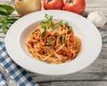 料理メニュー写真ベーコンとモッツアレラののトマトソース
