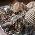 料理メニュー写真名物!海鮮ガンガン焼き(牡蠣・帆立・青つぶ2個・浅利3個)