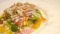 料理メニュー写真彩り野菜の生ハムシーザーサラダ