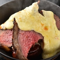 料理メニュー写真シュラスコの3種牛肉のラクレット