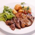 料理メニュー写真ほほ肉ガーリックステーキ