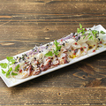 料理メニュー写真オホーツク海産タコのカルパッチョ和風トリュフソース