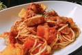 料理メニュー写真エビとベーコンのトマトパスタ