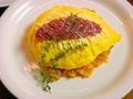 料理メニュー写真大人のオムライス(デミグラスソースとチーズのトッピング)
