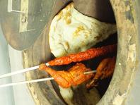 本格的な石釜で仕上げる料理