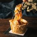 料理メニュー写真焦がしチーズの窯焼きボルケーノ
