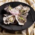 料理メニュー写真蒸し牡蠣のレモンクリームソース
