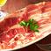 料理メニュー写真パルマ産ホエー豚の生ハム切り落としとパンチェッタ