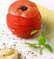 料理メニュー写真まるごと冷やしトマト/黒酢と胡麻の豆腐サラダ