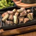 料理メニュー写真元祖 大山鶏と旨み葱の炭焼き