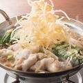 料理メニュー写真◆粉雪チーズと黄金味噌出汁で食べる牛もつ鍋