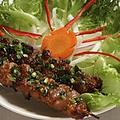 料理メニュー写真串焼き豚(2本)