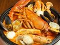 料理メニュー写真オマール海老の豪快ペスカトーレ