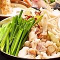 料理メニュー写真もつ鍋(醤油)/(とろろとんこつ)(とろろ味噌とんこつ)