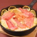 料理メニュー写真サーモン入りレモン風味のミルク炊き込みご飯【アロス・サルモン】