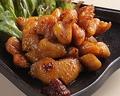 料理メニュー写真親鶏ぼんじりの漬け焼き