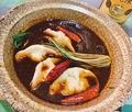 料理メニュー写真自家製水餃子とモチモチの板春雨の麻辣土鍋煮込み