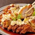 料理メニュー写真鶏の一枚揚げ ~ネギソース掛け~