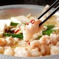 料理メニュー写真博多のもつ鍋(味噌) ⇒ 国産牛稀少部位と秘伝の出汁で野菜ともつをたっぷりと♪