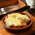 料理メニュー写真ハイジのラクレットチーズ ソーセージ